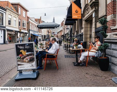 Haarlem, The Netherlands - Jul 21, 2018: Dutch Street Scene With Large Open Terrace People Eating, D