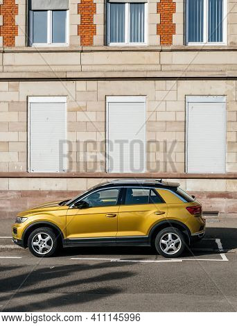 Strasbourg, France - Feb 23, 2019: Yellow Mustard Color Of New Volkswagen Vw T-roc Suv Parked In Fro