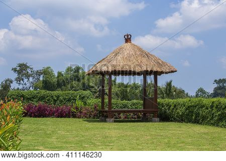Wooden Arbor With Straw Roof For Relaxing In The Tropical Garden. Island Bali, Ubud, Indonesia