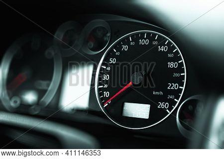 Luxury Car Speedometer Close Up. Speedometer Arrows In Dark Colors.