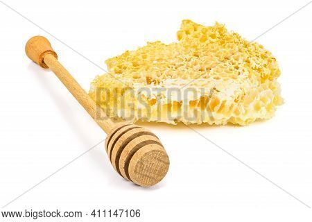Piece Of Honeycomb With Honey Dipper On White Background Isolated On White Background With Clipping