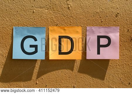 Gdp - Gross Domestic Product, Word From Colorful Paper Notes On Wall.