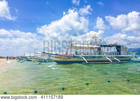 Palawan, Philippines - September 27, 2018: Colorful Boats In Clear Azure Water On Beach Philippines