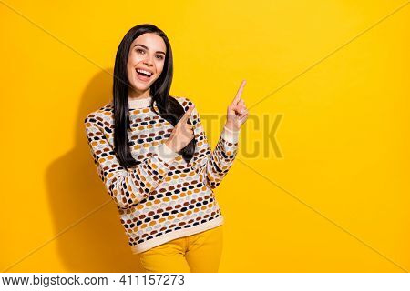 Photo Of Young Attractive Lovely Happy Excited Smiling Girl Pointing Finger Copyspace Isolated On Ye