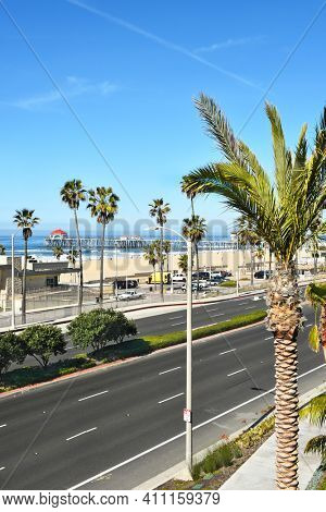 HUNTINGTON BEACH, CA - MARCH 25, 2015: Huntington Beach pier and coastline seen from the Pacific City Development.