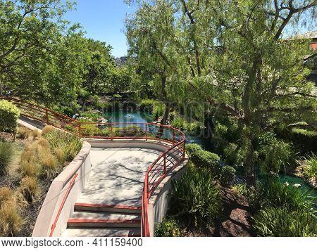 COTO DE CAZA, CALIFORNIA - JULY 20, 2019: Walkway and pond at the Coto de Caza Golf and Racquet Club.