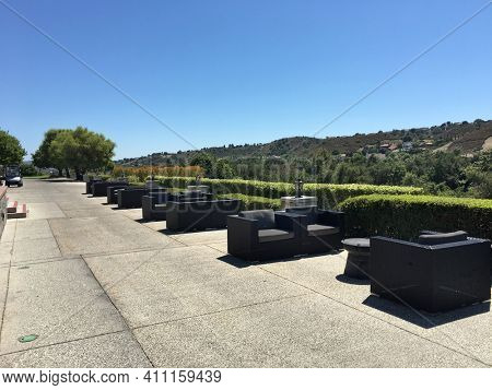 COTO DE CAZA, CALIFORNIA - JULY 20, 2019: Clubhouse outdoor seating at the Coto de Caza Golf and Racquet Club, a private 36-hole country club in Orange County that offers tennis and a spa.