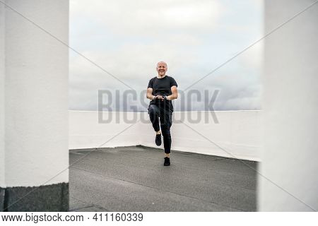 A Man Doing Cardio Exercises On The Rooftop During Lockdown