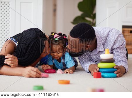 Cute African American Family Having Fun Together On The Carpet At Home
