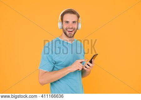 Get Music Family Subscription. Man Listen Music Modern Headphones And Smartphone. Listen For Free. E