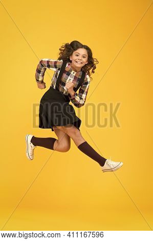 Run For Fun. Happy Kid Have Fun Yellow Background. Little Child In Midair. School Holidays. Play And
