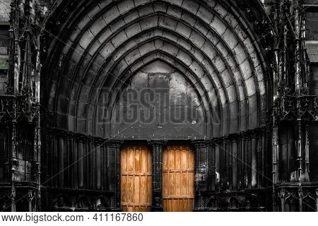 Entrance To Historic Building With Wooden Doors, Which Are Divided By Column In Middle. Area Around