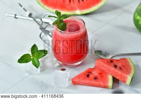 Fresh Watermelon Juice With Mint And Ice In The Glass On White Table. Summertime. Copy Spase. Select