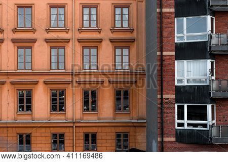 Housing With Historic Elements, Straight Lines And Wooden Windows. Next To Historic Building Is Apar