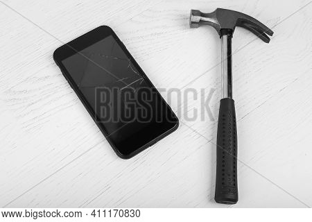 Repair Workplace With Phone And Special Tools. Electronics Repair Service. Broken Phone With Hammer