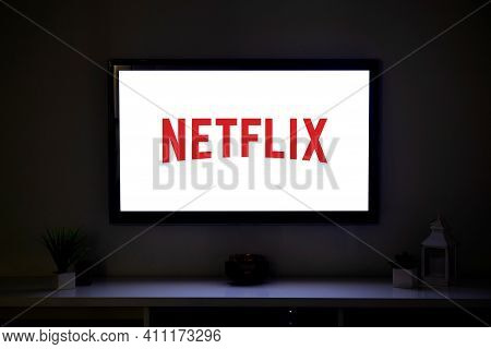 Rosario, Argentina - March 4, 2021: Netflix Logo On The Screen Of Lcd Smart Tv In The Middle Of A Li