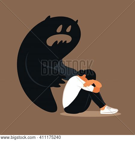 Fear Or Panic Attack. Sad Woman With Lowered Head Frightened With His Own Shadow. Depressed, Solitud
