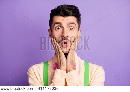 Photo Of Funny Impressed Young Man Dressed Yellow Shirt Arms Cheeks Isolated Purple Color Background