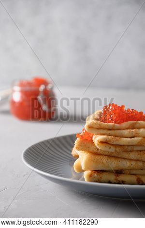 Russian Thin Pancakes Or Blini With Red Caviar. Shrovetide. Close Up. Vertical Format.