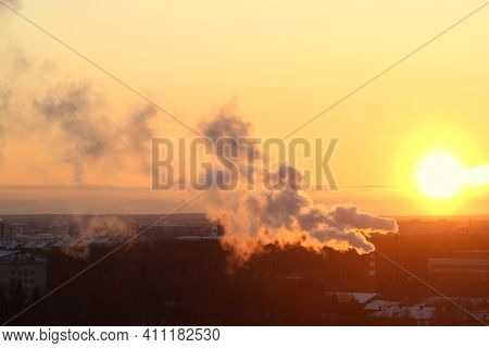 Sun Below The Horizon And Clouds In The Fiery Dramatic Orange Sky At Sunset Or Dawn Backlit By The S