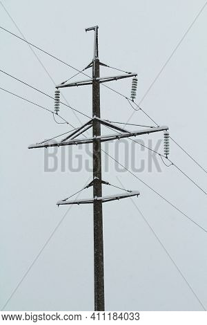 Wooden Pole Power Line On Winter Blue Sky Backgound. Stock Photo With Empty Space For Text And Desig