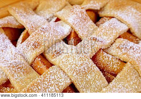 Closeup Of Woven Lattice Homemade Apple Pie Top Crust Dusted With Icing Sugar