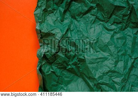 Blank Paper Background. Green Crumpled Paper On A Orange Background.olive Green Blank Paper Backgrou