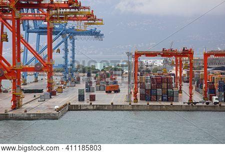 Rijeka, Croatia - October 17, 2014: Mobile Cranes Loading Cargo Containers At Adriatic Gate Port In