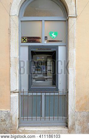 Rovinj, Croatia - October 15, 2014:  Raiffeisen Bank Automated Teller Machine In Wall Rovinj, Croati