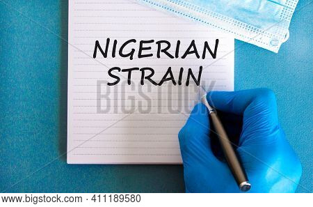 New Covid-19 Nigerian Strain Symbol. Hand In Blue Glove With White Card. Concept Words 'nigerian Str