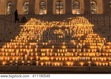 Finland, Helsinki. March 5, 2021. People Light Candles In Front Of The Parliament Building. Also, Ca