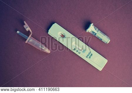 Test For Coronavirus On A Purple Background. On A Matte Background A Sensitive Strip For Coronavirus