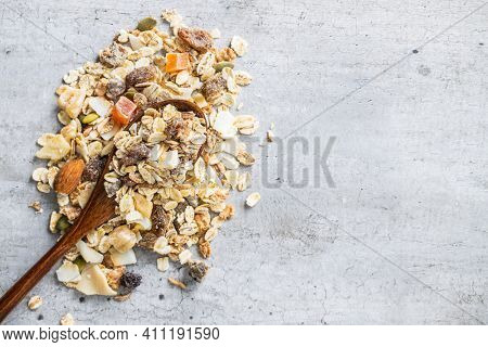 Beakfast cereals . Healthy muesli with oat flakes, nuts and raisins. Top view.