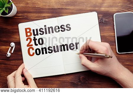 B2c Concept. Business To Consumer On On A Notebook.