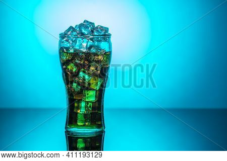 Original Glass Of Coca Cola With Ice And Coca Cola. Uk, England, March 3, 2021
