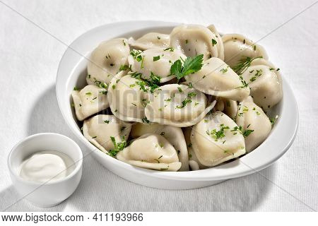 Boiled Or Steamed Pelmeni In White Bowl. Pelmeni Are Homemade Pasta With Mince Meet Filling Wrapped