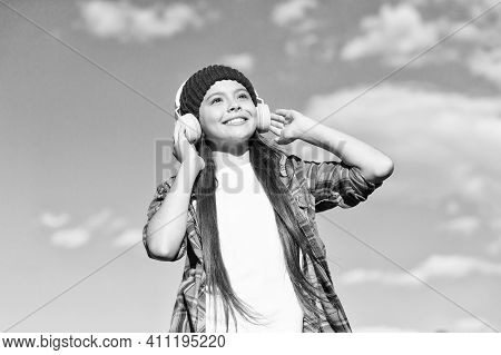 Fly High With English. Happy Kid Listen To Music On Sunny Blue Sky. Audio Learning. Listening Compre
