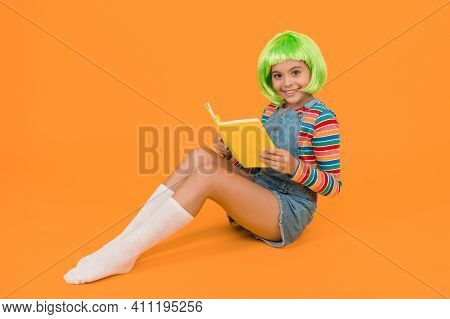 Relax And Read Book. Adorable Small Child Read Book Yellow Background. Cute Little Girl Enjoy Readin
