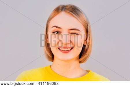Cute Young Female With Delicate Features Wearing Yellow Sweater Blinking Her Eyes With Pleasure Havi