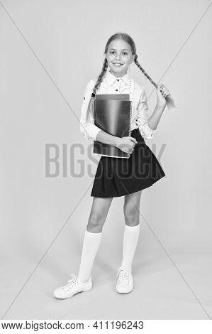 Cute Schoolgirl. School Education. Courses For Gifted Children. Basic Level. Happy Schoolgirl Hold T