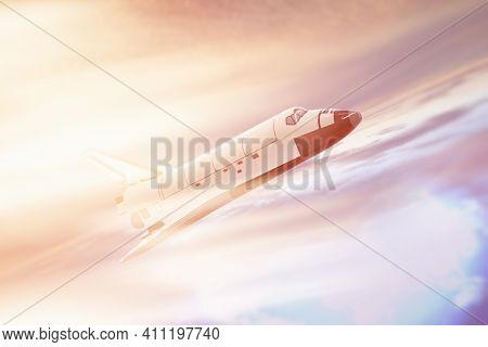 Spaceship Flies In The Stratosphere Against The Background Of The Sky With Clouds And Bright Sunligh