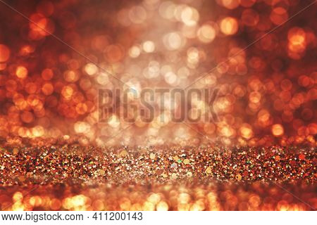 Shiny Background. Beautiful Glowing Bokeh. Bright Glowing Background. Shiny Glowing Effect. Orange G