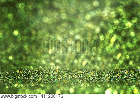 Shiny Background. Beautiful Glowing Bokeh. Bright Glowing Background. Shiny Glowing Effect. Green Gl