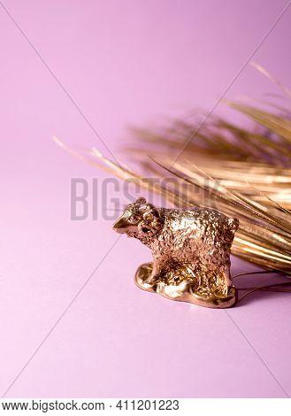 Golden Lamb Figure Against A Lilac Background. Sheep Symbol Of Eid Al-adha Mubarak Or Feast Of The S
