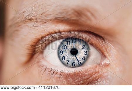 Concept Of Aging, Time Flies Of Man. Clock Dial On Eye. Close-up. Hours. Minutes On The Face