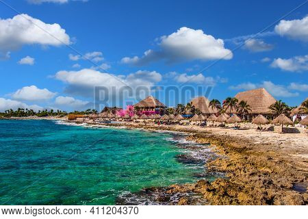 Colorful Huts On A Rocky Beach In Mexico