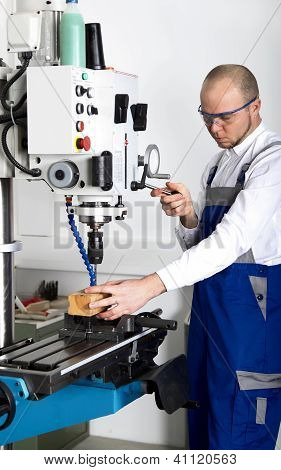 Worker At Milling Machine
