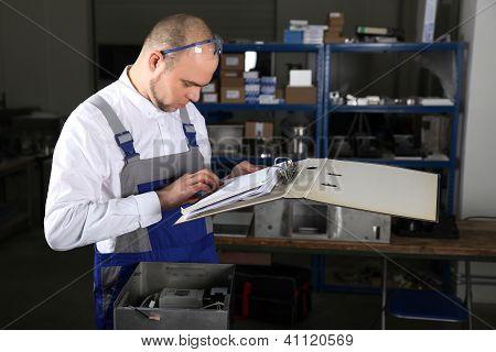 Workman In Blue Overalls