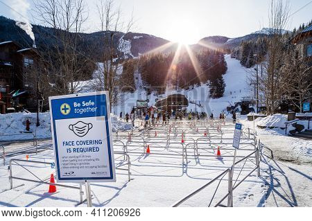 Whistler, Bc, Canada - Feb 18, 2021: Large Ski Lift Line Up Of Skiiers Due To Covid 19 Restrictions