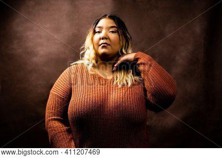 Black Girl Flips Hair Wearing Orange Sweater